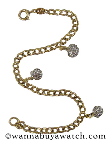 14K Yellow Gold Bracelet with Platinum Charms