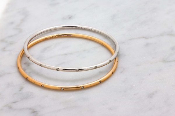 Tiffany & Co. Bezet 18K White Gold Diamond Bangle Bracelet circa 2000s